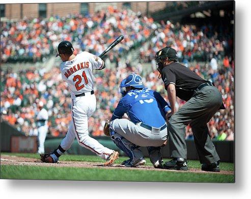 American League Baseball Metal Print featuring the photograph Nick Markakis by Rob Tringali