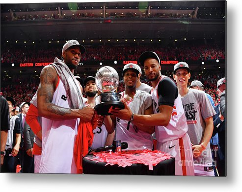 Nba Pro Basketball Metal Print featuring the photograph Norman Powell, Kawhi Leonard, and Kyle Lowry by Jesse D. Garrabrant