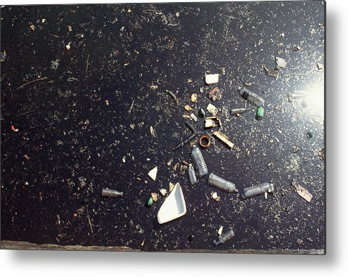 Air Pollution Metal Print featuring the photograph Oil spill in water by James Hardy
