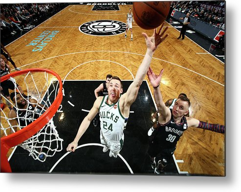 Nba Pro Basketball Metal Print featuring the photograph Pat Connaughton by Nathaniel S. Butler