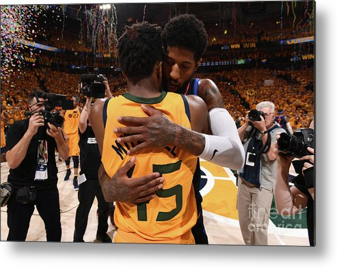 Playoffs Metal Print featuring the photograph Paul George and Donovan Mitchell by Garrett Ellwood