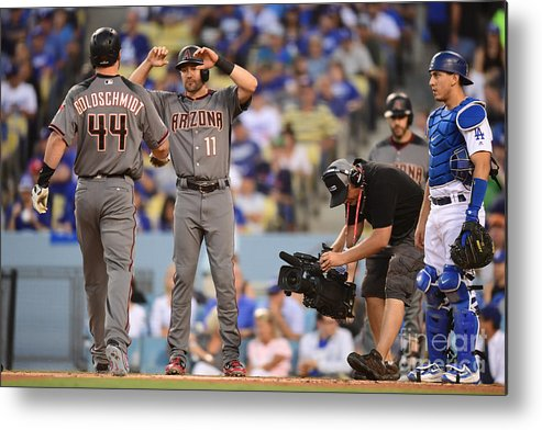 Game Two Metal Print featuring the photograph Paul Goldschmidt and Austin Barnes by Harry How
