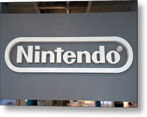 Corporate Business Metal Print featuring the photograph Product Displays Inside The Nintendo Game Front Showroom by Bloomberg