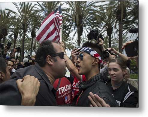 Democracy Metal Print featuring the photograph Protestors Rally Outside Trump Campaign Event In Anaheim by David McNew