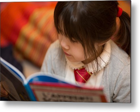 Child Metal Print featuring the photograph Reading a book by Benoist SEBIRE