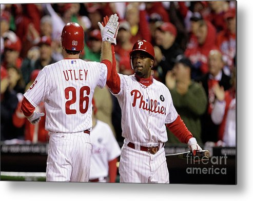 Game Two Metal Print featuring the photograph Ryan Howard, Jimmy Rollins, and Chase Utley by Rob Carr