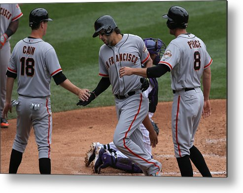 Mike Morse Metal Print featuring the photograph San Francisco Giants v Colorado Rockies by Doug Pensinger