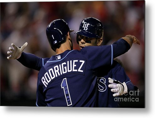 Sean Rodriguez Metal Print featuring the photograph Sean Rodriguez and Carlos Pena by Stephen Dunn