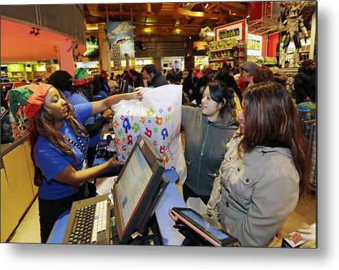 Thanksgiving Metal Print featuring the photograph Shoppers Inside Toys R Us Inc. Stores Ahead Of Black Friday Sales by Bloomberg