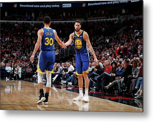 Nba Pro Basketball Metal Print featuring the photograph Stephen Curry and Klay Thompson by Jeff Haynes