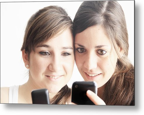 People Metal Print featuring the photograph Teenage girls using cell phones by Sigrid Gombert