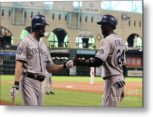 American League Baseball Metal Print featuring the photograph Todd Helton and Dexter Fowler by Scott Halleran