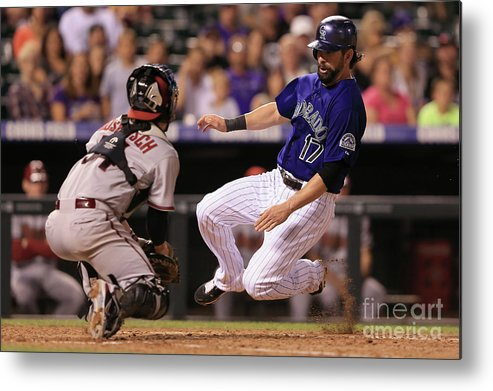 Baseball Catcher Metal Print featuring the photograph Todd Helton and Jordan Pacheco by Doug Pensinger