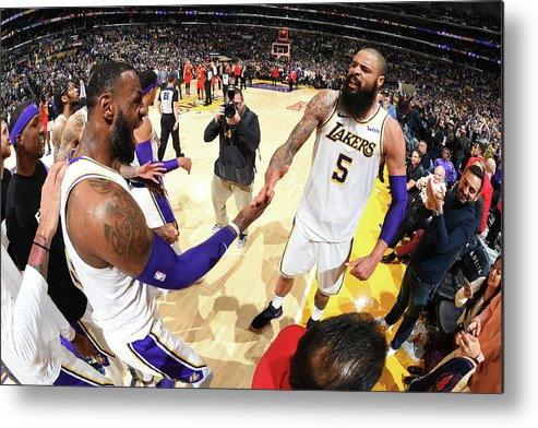 Nba Pro Basketball Metal Print featuring the photograph Tyson Chandler and Lebron James by Andrew D. Bernstein