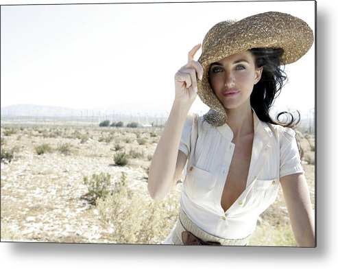 Wind Metal Print featuring the photograph Woman outdoors holding large hat by Eye Candy Images