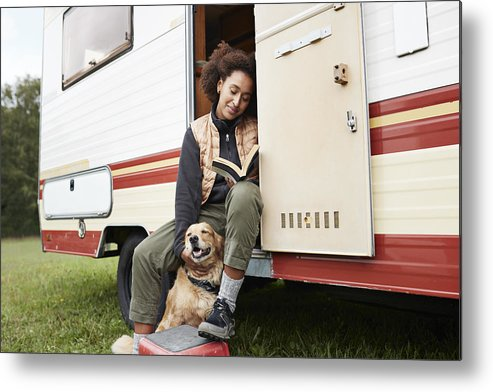 Pets Metal Print featuring the photograph Woman with dog reading book in motor van by Klaus Vedfelt