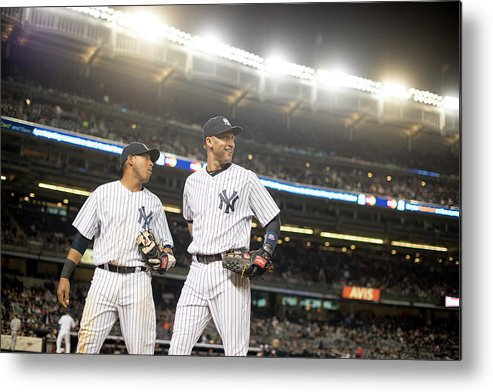 American League Baseball Metal Print featuring the photograph Yangervis Solarte and Derek Jeter by Rob Tringali