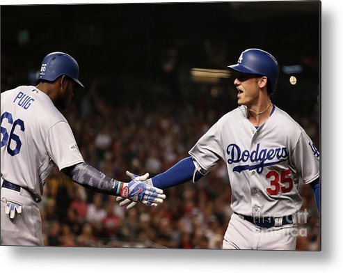 Three Quarter Length Metal Print featuring the photograph Yasiel Puig and Cody Bellinger by Christian Petersen