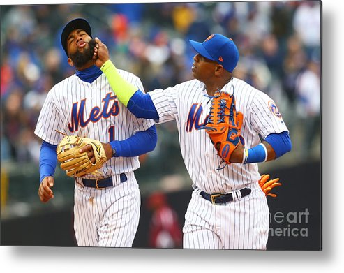 Yoenis Cespedes Metal Print featuring the photograph Yoenis Cespedes and Amed Rosario by Mike Stobe
