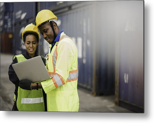 Working Metal Print featuring the photograph Young African american men and woman worker Check and control loading freight Containers by use computer laptop at commercial shipping dock felling happy. Cargo freight ship import export concept by Niphon Khiawprommas