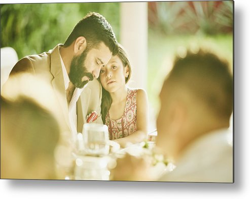 Mature Adult Metal Print featuring the photograph Young girl embracing father during outdoor wedding reception dinner by Thomas Barwick