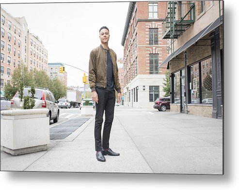 People Metal Print featuring the photograph Young man standing on city sidewalk by Tony Anderson