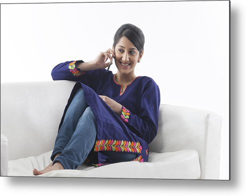 White Background Metal Print featuring the photograph Young woman talking on her cell phone by Hemant Mehta