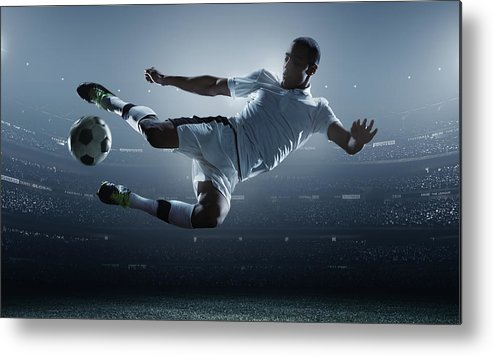 Goal Metal Print featuring the photograph Soccer Player Kicking Ball In Stadium by Dmytro Aksonov