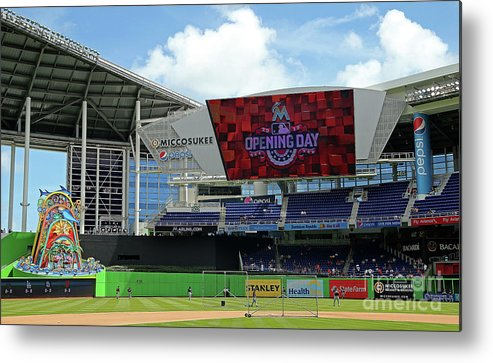 American League Baseball Metal Print featuring the photograph Atlanta Braves V Miami Marlins by Mike Ehrmann