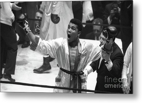 Heavyweight Metal Print featuring the photograph Cassius Clay Vs Doug Jones by The Stanley Weston Archive