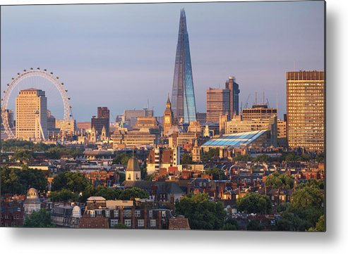 Tranquility Metal Print featuring the photograph City Skyline In Late Evening Sunlight by Simon Butterworth