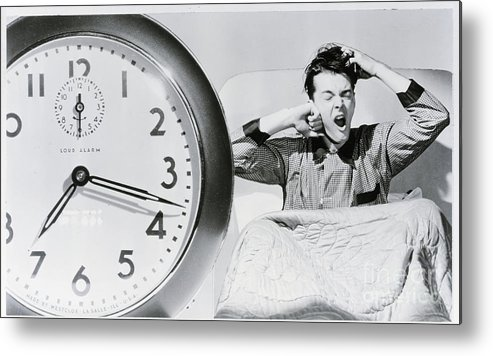 People Metal Print featuring the photograph Man Waking Up To Alarm Clock by Bettmann
