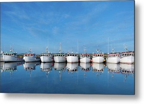 Iles De La Madeleine Metal Print featuring the photograph Row Of Boats With Reflection by Pndtphoto