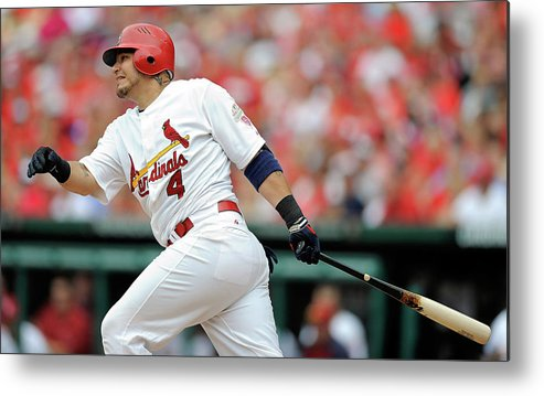 Following Metal Print featuring the photograph Yadier Molina by Jeff Curry