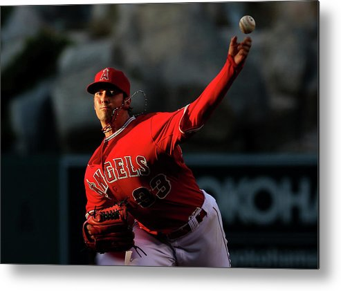 American League Baseball Metal Print featuring the photograph Minnesota Twins V Los Angeles Angels Of by Stephen Dunn