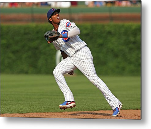 Following Metal Print featuring the photograph Pittsburgh Pirates V Chicago Cubs by Jonathan Daniel