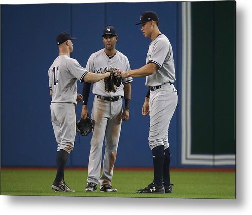People Metal Print featuring the photograph New York Yankees v Toronto Blue Jays by Tom Szczerbowski