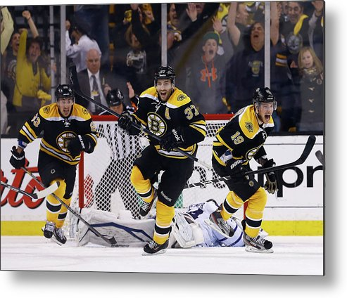 Following Metal Print featuring the photograph Toronto Maple Leafs V Boston Bruins - by Jared Wickerham