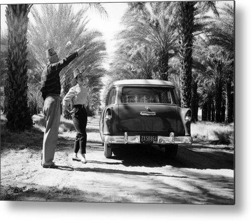 Headwear Metal Print featuring the photograph Couple With A 1955 Chevrolet Townsman by Heritage Images