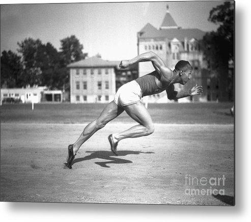 Young Men Metal Print featuring the photograph Jesse Owens Running A Sprint by Bettmann