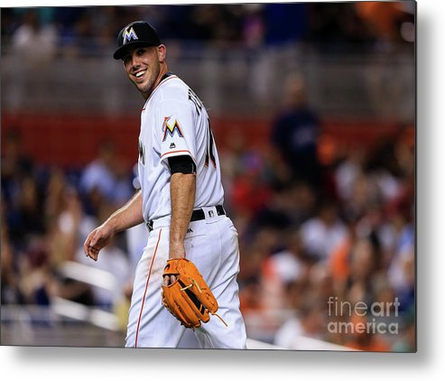 Looking Over Shoulder Metal Print featuring the photograph Kansas City Royals V Miami Marlins by Rob Foldy