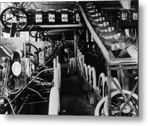 1910-1919 Metal Print featuring the photograph Moving Assembly Line by Hulton Archive