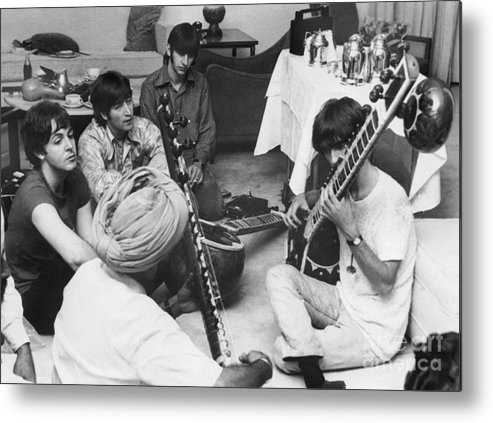 Education Metal Print featuring the photograph Musician George Harrison Receiving by Bettmann