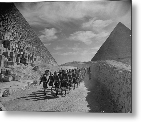 Marching Metal Print featuring the photograph Scottish Cameron Highlander And Indian T by Margaret Bourke-white