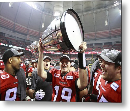 Hoisting Metal Print featuring the photograph 102nd Grey Cup Championship Game by Jeff Vinnick