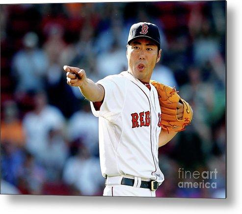 American League Baseball Metal Print featuring the photograph Koji Uehara by Jim Rogash