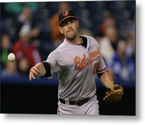 American League Baseball Metal Print featuring the photograph Alcides Escobar and Darren O'day by Ed Zurga