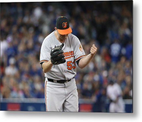 Three Quarter Length Metal Print featuring the photograph Baltimore Orioles v Toronto Blue Jays by Tom Szczerbowski