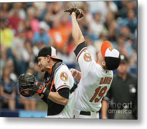 American League Baseball Metal Print featuring the photograph Chris Davis and Caleb Joseph by Cliff Mcbride