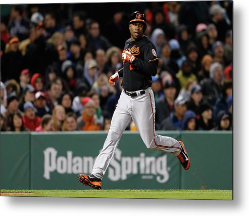 American League Baseball Metal Print featuring the photograph Delmon Young and Matt Wieters by Jim Rogash